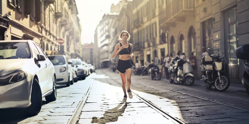 photo-of-woman-listening-to-music-on-earphones-jogging-down-3764558-1920x1040